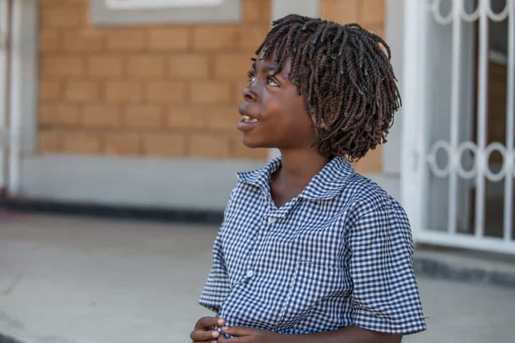 A photo of a pupil in school uniform to illustrate our education support work