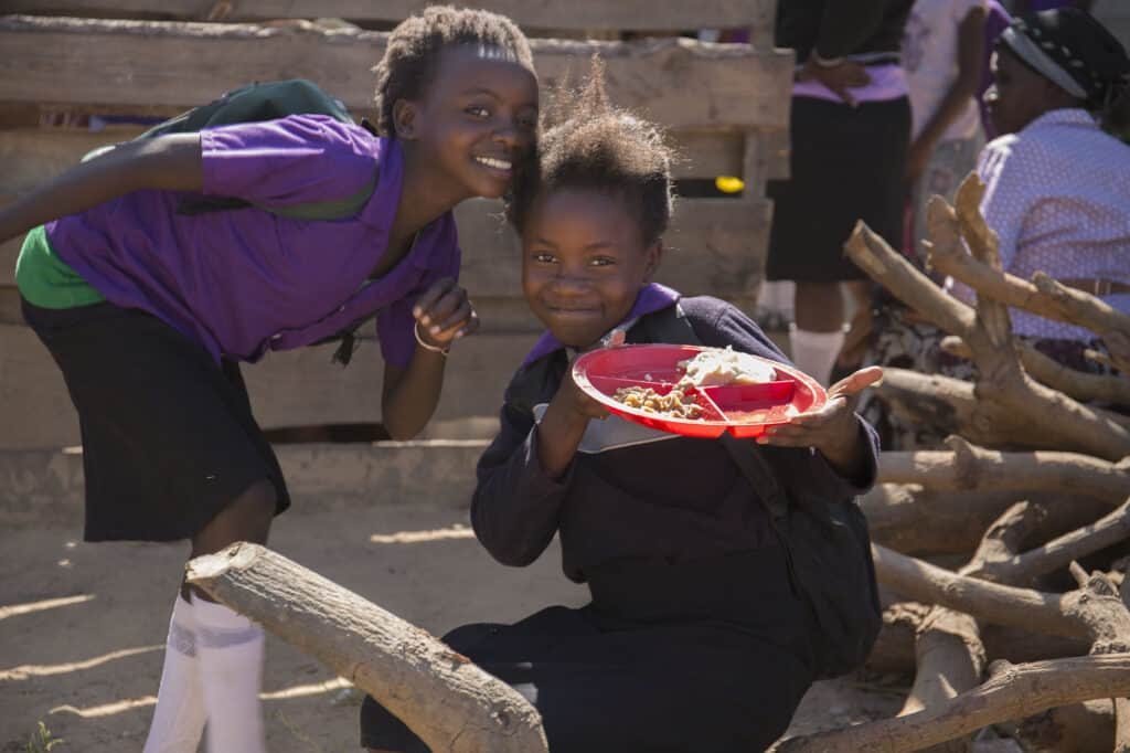 A photo showing two pupils at Twavwane School with their lunch illustrating our nutrition work
