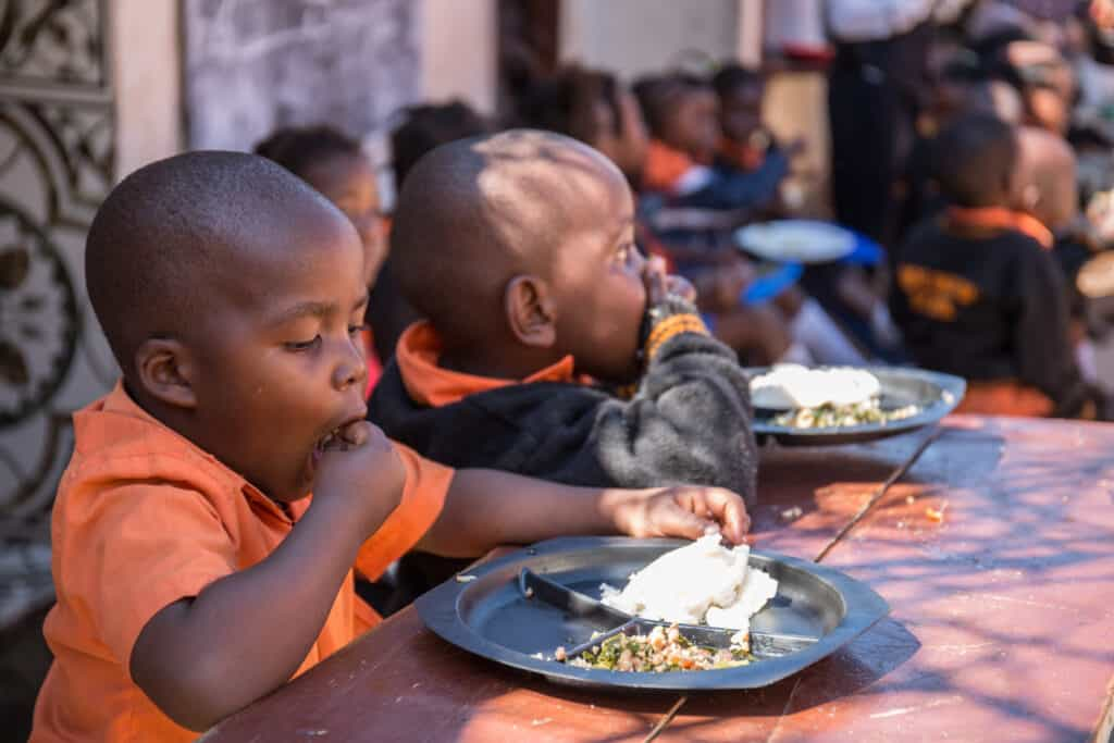 A photo of pupils at Hope and Faith School eating their lunch to illustrate our work