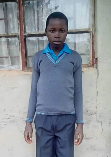A portrait of Mpaso Phiri to accompany his testimonial about the support he's received to go to school