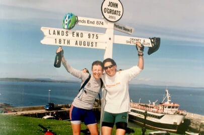 A photo of cyclists at John O'Groats to illustrate our community fundraising page