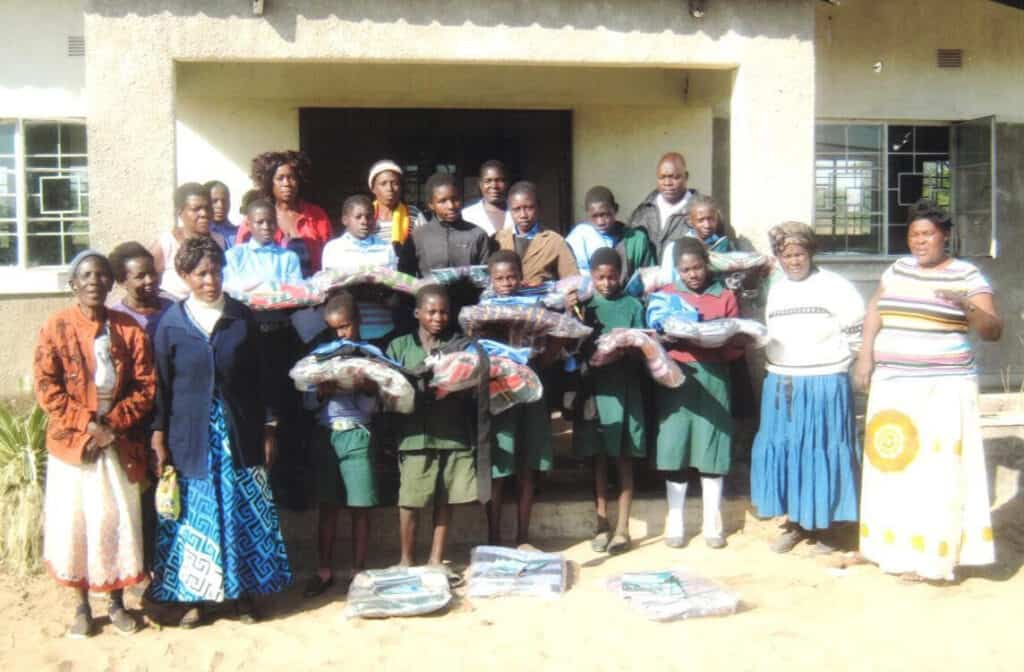 A photo showing children from Kalends Primary School receiving their school uniforms
