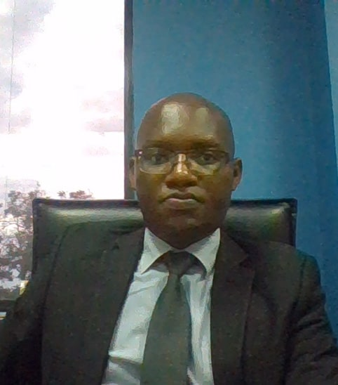 A portrait of Nkaka Kasonda, ZOA-Z trustee, to accompany his biography