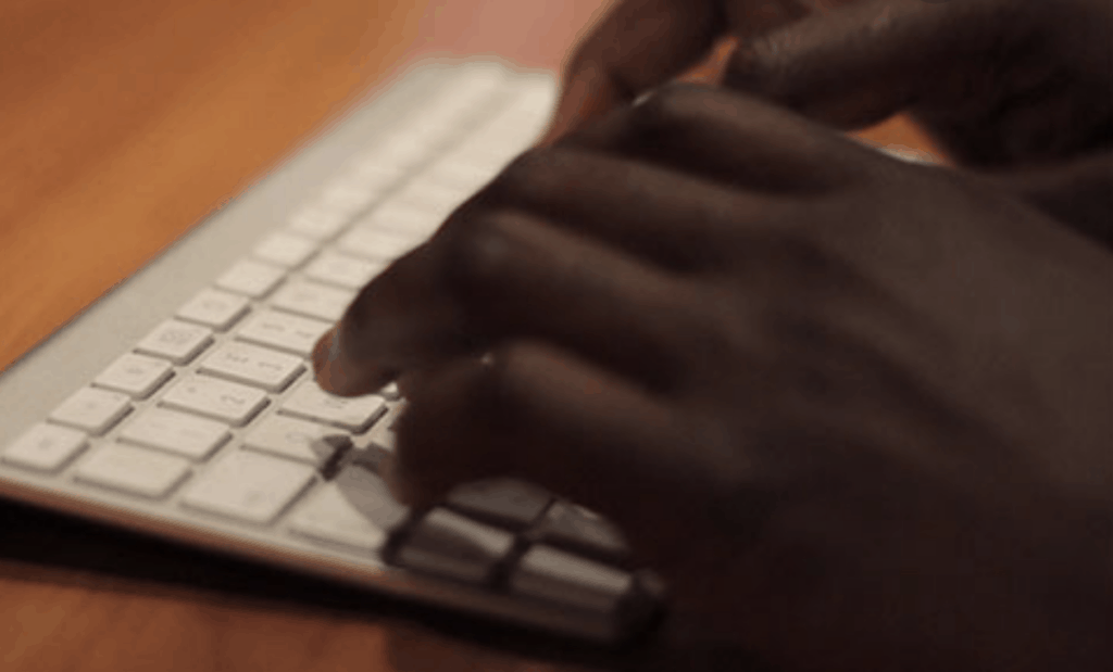 A photo of hands typing on a key board to illustrate ways to contact us